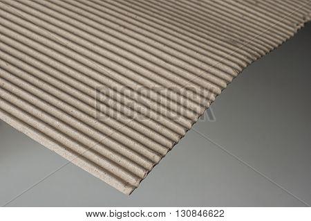 close up shot of corrugated cardboard on white background
