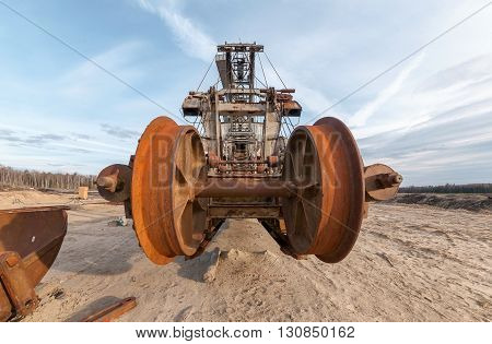 Many buckets of giant quarry excavator Equipment for the extraction of sand from the quarry. Close-up on front view