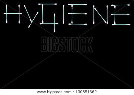The word 'hygiene' composed of turquoise cotton swabs isolated on black