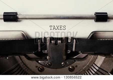 Tax Concept. Old typewriter with paper, close up