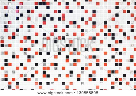 Checkered pattern tile background. Architectural detail, abstract background pattern. White, red and black checks.