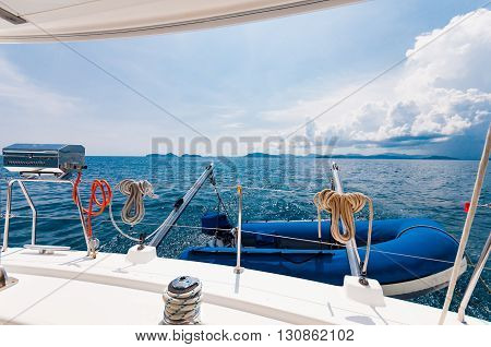 Rear of the luxury yacht with dingy and BBQ party equipment