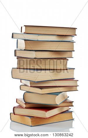Stack of new and old books isolated on white