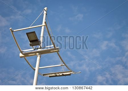 Low angle view of lighting equipamente and pole