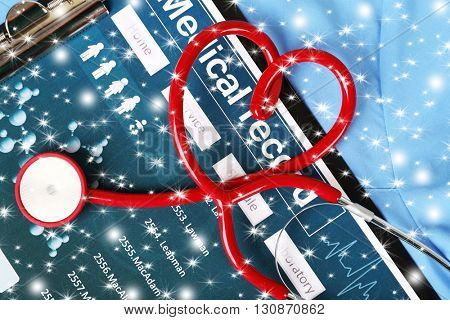 Red heart shaped stethoscope and medical record on blue uniform with snow effect