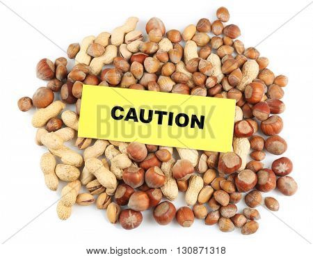 Allergy food concept. Pile of nuts isolated on white