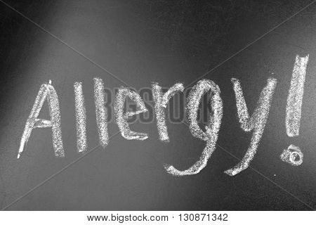 Word ALLERGY on blackboard background