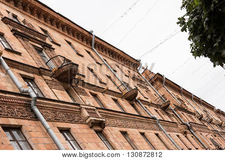 A beautifully built old historical building on Independence Avenue on a bright day. Every balcony is decorated in most houses and the architecture is simply marvellous. Minsk was rebuilt 90 after the German Plunderings in WWII