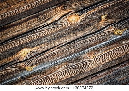 Old stained board. A dark background