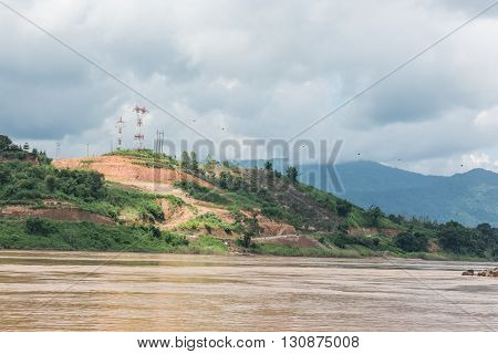 View of a hill from the Mekong river in Laos. Mrking is the largest trans-boundary Southeast Asian river in Laos, originating from Lasagongma spring. The river is surrounded by hills.