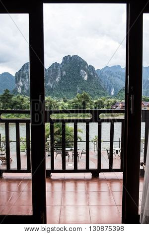 View of the Karst mountainland from a hotel in Vang Vieng. Vang Vieng is a riverside party town on the banks of Nam Song river. Vang Vieng is famous as the best party town.