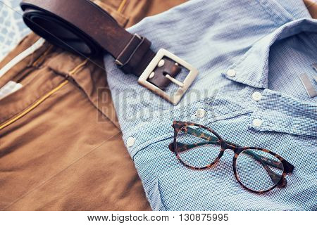 Men's casual outfits background, Blue shirt, brown short pants, brown belt, glass.