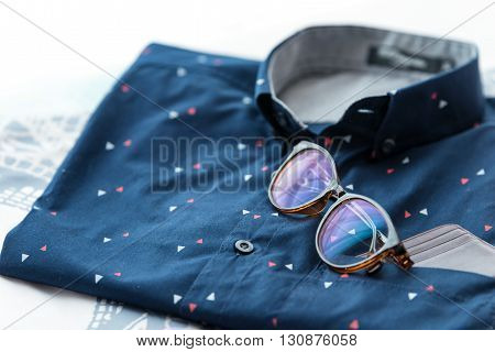 Men's casual outfits background, Blue shirt and glass.