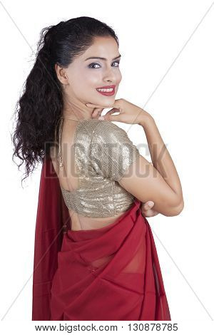 Photo of happy Indian woman wearing a red saree clothes and smiling at the camera in the studio isolated on white background