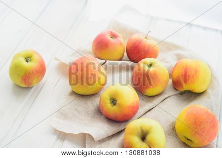apples on a white rag on the gray wooden background top view rustic idea