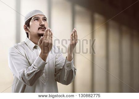 Image Of Young Muslim Man Praying