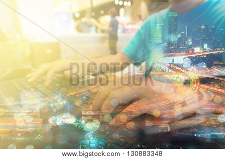 Double Exposure Of Man With Laptop Computer And Metro City