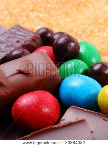 A lot of candies and cookies with brown cane sugar too many sweets unhealthy food reduction of eating sweets