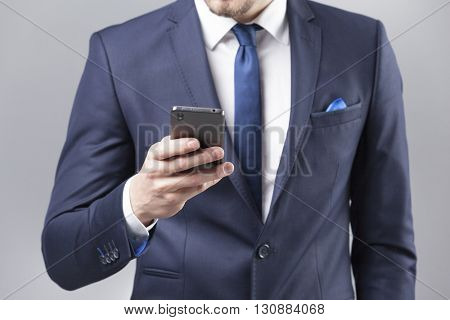 Businessman reading a message on the smart phone