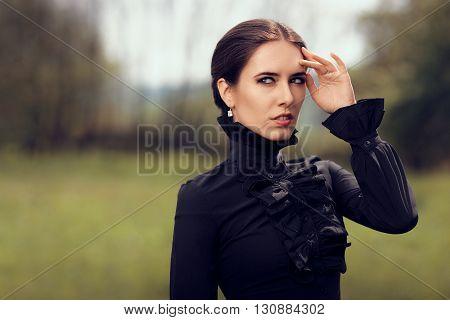 Portrait of a Gothic Queen Outside Wearing Diamond Earrings