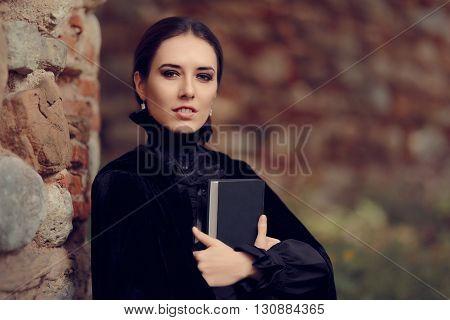 Beautiful Dark Princess Reading a Book Outside