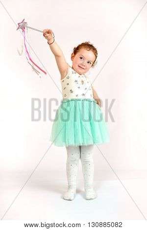 Fashion little girl in green dress in catwalk model pose stock photo. Image 01