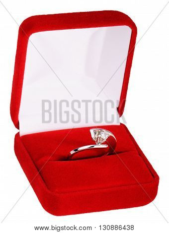 Silver finger ring with precious stone in red box isolated on white