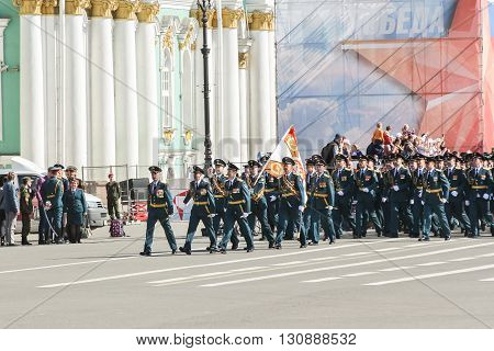 St. Petersburg, Russia - 9 May, Military unit with a flag on the march, 9 May, 2016. Festive military parade on the Palace Square in St. Petersburg.