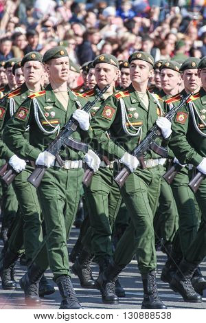 St. Petersburg, Russia - 9 May, A group of soldiers with Kalashnikovs in the parade, 9 May, 2016. Festive military parade on the Palace Square in St. Petersburg.