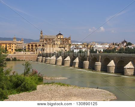 Ancient Roman Bridge River Guadalquivir Cordoba Spain Roman bridge was built in the 1st Century BC. The Great Mosque (currently Catholic cathedral). UNESCO World Heritage Site.