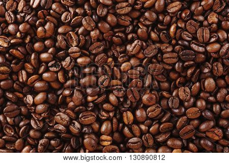 Coffee beans closeup background. Roasted coffee beans