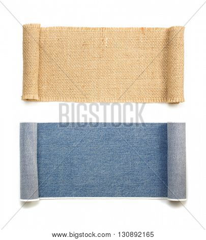 blue jeans and burlap sack roll isolated on white background