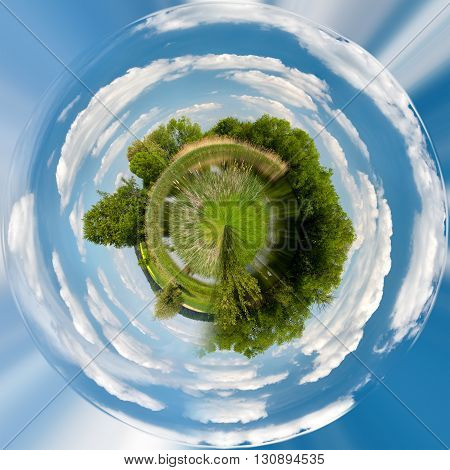 Tiny planet of Beautiful summer rural landscape with small lagoon. Rural landscape with pond. Spring landscape. Green czech countryside. Beautiful highland vysocina european countryside