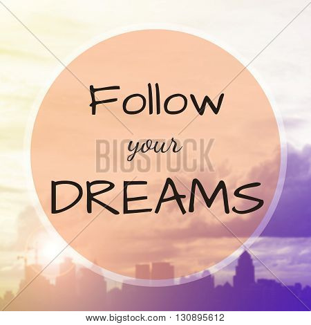 Inspirational quote : Follow your dreams on blur background
