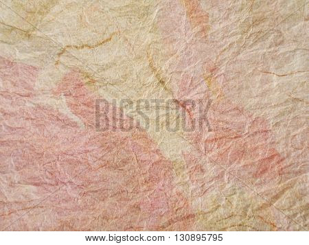 Color splashes added to crumpled textured paper