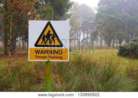 Troop warning sign in wooded training area