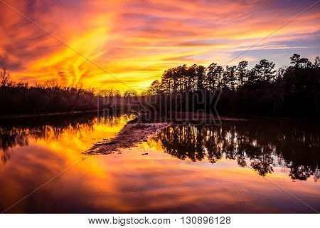 an orange sunset reflection over the lake