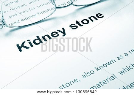 Kidney stone sign on a paper and glasses.