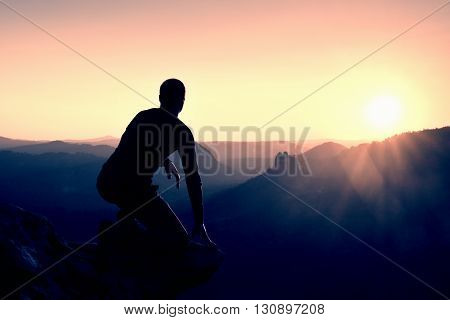 Alone Male Hiker In Mountain Landscape At Sunset At Horizon. Beautiful Colorful Mountain Panorama In