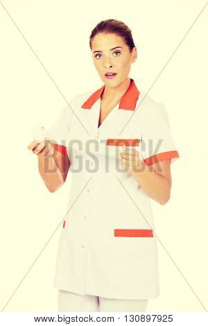 Young female nurse or doctor holding a bandage