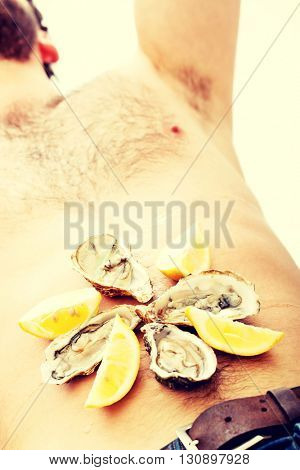 Oysters on man's belly.