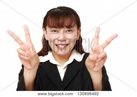 portrait of Asian Businesswoman showing a victory sign on white background