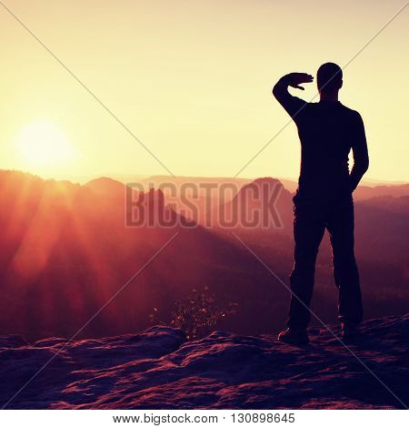 Young Sportsman Shadowing His Eyes From Bright Rays Of Daybreak Sun