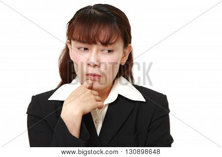 portrait of Asian businesswoman worries about something on white background