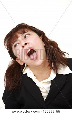 studio shot of demented businesswoman on white background
