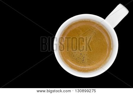 Cup of fresh espresso on black background view from above with clipping path and copyspace.
