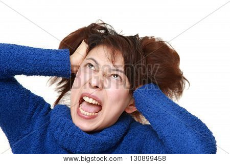 studio shot of demented woman on white background