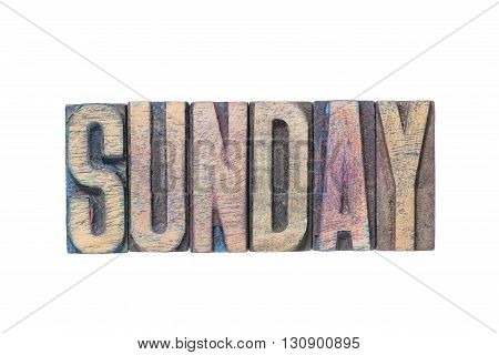 Sunday word made from wooden letterpress type isolated on white