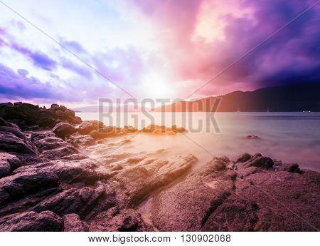 Colorful long exposure ocean in sunset, vintage tone