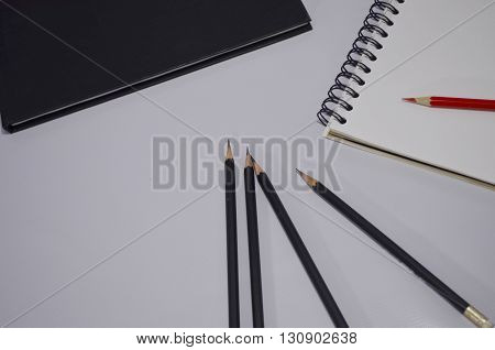 Notebooks and pencils for taking notes Business Report.